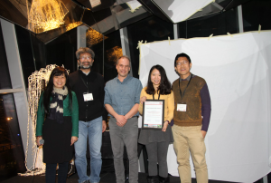 Phoebe Chen, Laurent Amsaleg and Shin'ichi Satoh (left) present the Best Student Paper Award to Jingjing Chen and Chong-Wah Ngo (right).