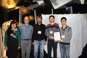 Phoebe Chen, Laurent Amsaleg and Shin'ichi Satoh (left) present the Best Paper Award to Yu Liu and Yanming Guo (right).
